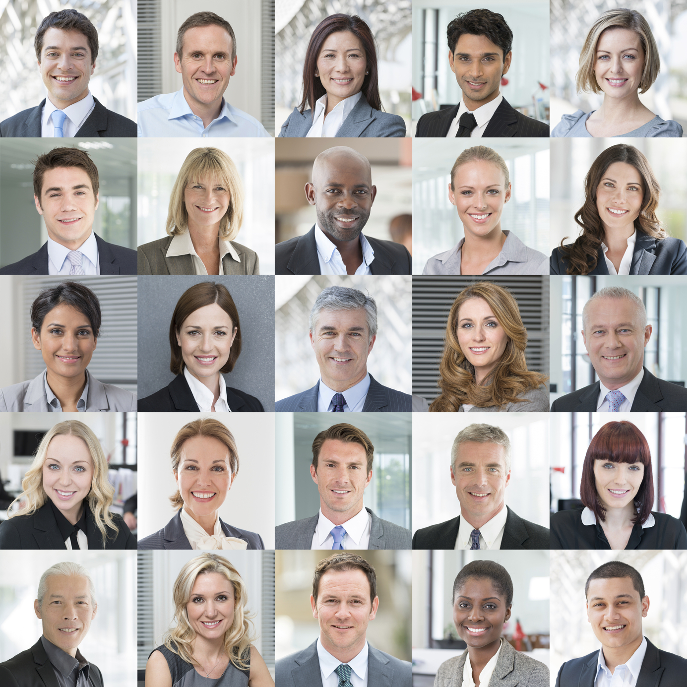 Headshot portraits of 25 different diverse business people smiling to camera.